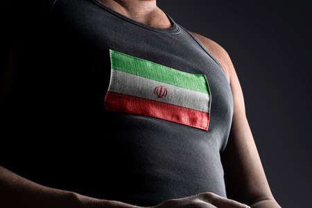 The national flag of Iran on the athletes chest