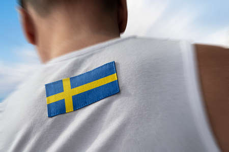 The national flag of Sweden on the athletes back