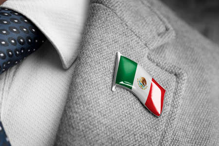 Metal badge with the flag of Mexico on a suit lapel