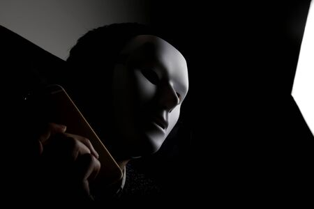 rational: Mask man in dark background Stock Photo