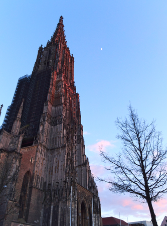 Ulm Minster illuminated by red light at sunset Stock Photo