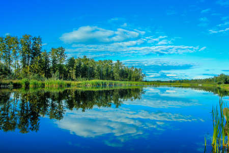 Cloudy reflection over The Narrows Provincial Recreation Area, Alberta, Canada Stock Photo