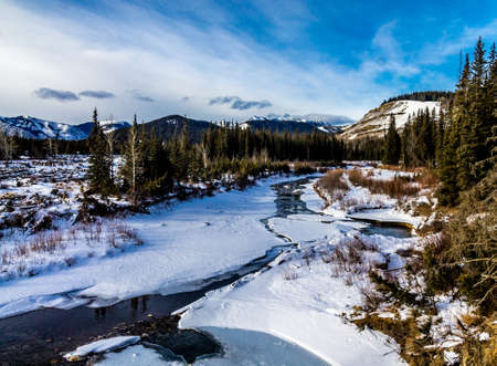 Early thaw on the creek, Deer Creek Provincial Recreation Area Stock Photo