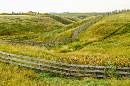 Farmers field and rustic fence, Kneehill County, Alberta, Canada 写真素材