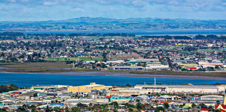 the city of Auckland sits on the north island of New Zealand and shows its quaint living