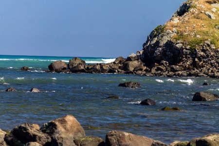 the jagged beach line along the coast of Cape Edgemont in the Taranaki region of New Zealand