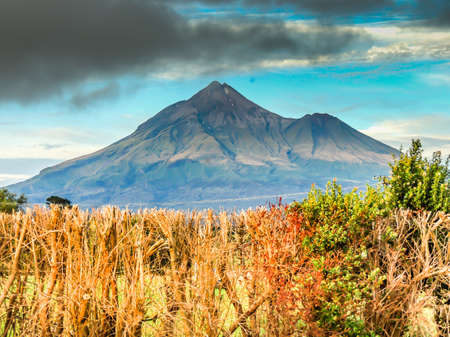 Mount Taranaki is an active volcano that sits ont he west coast of new zeland in the taranaki region. It is aslo called mount edgemont.