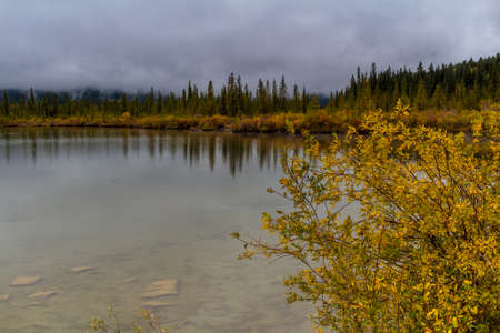 Sunrises, clear lakes, mountains, ducks and birds are always on the menu at Vermillion Lakes in banff Stock Photo