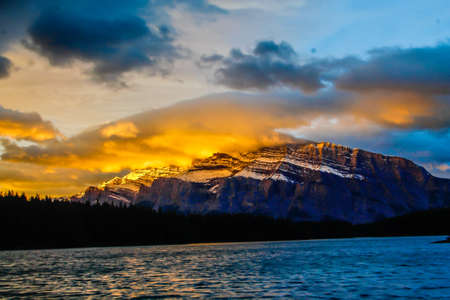 Two Jack Lake is a stunning view in the morning, still lake reflections and mountain views are always in high demand Stock Photo