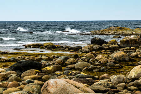 Water of the seaway meets the rocks of Green Point, Grose Morne National Park, Newfoundland, Canada