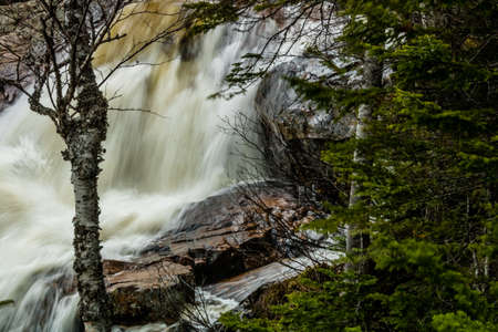 Waves crashing over the rocks of East Brooke Falls, Gros Morne NationL Park, Newfoundland, Canada Stock Photo