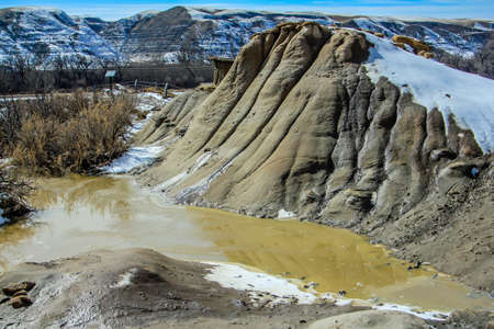 cnetries of age and wear and tear show on the hills and valleys in the badlands in drumheller 写真素材