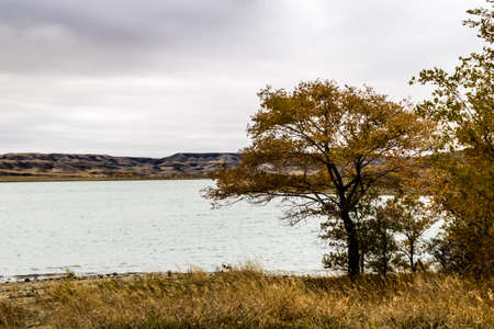 Gloomy snow laden skies get ready to put the finishing touches on summer over diefenbaker lake