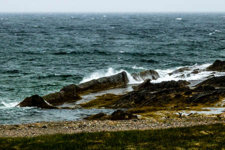Stormy skies and seaway at Broom Point, Gros Morne National Park, Newfoundland, Canada