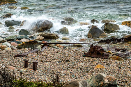 Wreckage of the SS Ethir stewn on the beach during rough seas, Gros Morne National Park, Newfoundland, Canada