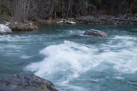 the power of the might kananaskis river shows as it carves its way through the canyon