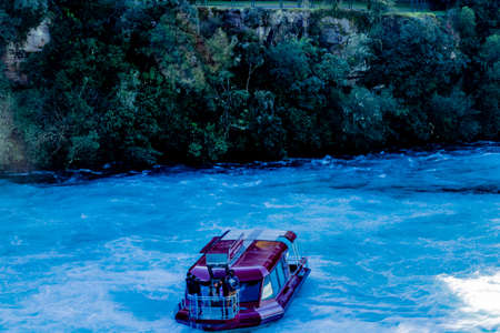 River cruises are popular around the falls, Taupo, New Zealand 版權商用圖片