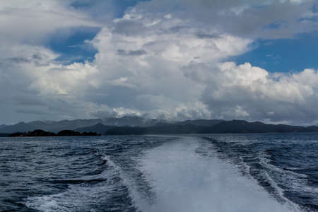 Stormy, skies, blue skies, dotted rock islands are a pleasant view durinf a cruise around the Bay of Islands Archivio Fotografico - 122142537