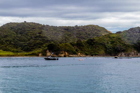 Stormy, skies, blue skies, dotted rock islands are a pleasant view durinf a cruise around the Bay of Islands Archivio Fotografico