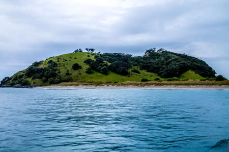 loney islands, bright blue skies, small and large islands, lonely islands, studded with trees, there are many suprises on a trip around the bay of islands