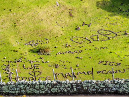 Scenics views and rock formations and writing on Mount Eden, Auckland, New Zealand Stock Photo