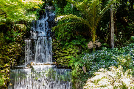 Flower gardens, water falls, fountains and several ponds highlight a day in the park for tourists and locals alike Stock Photo