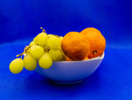 Colourful fruit in a white bowl against a colouful back drop. Calgary, Alberta, Canada 免版税图像