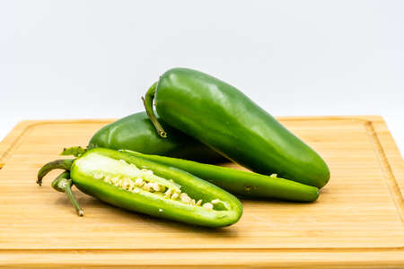 Jalapeno peppers on a wooden cutting board. Calgary, Alberta, Canada