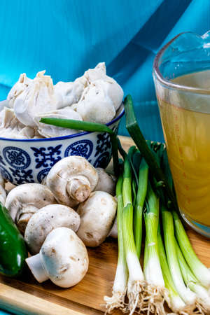 Won ton soup ingredients on a wooden cutting board. Calgary, alberta, Canada Stock Photo