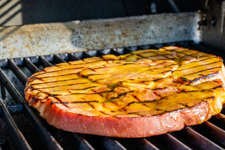 Ham steak with honey mustard glaze on the grill. Calgary, Alberta, Canada