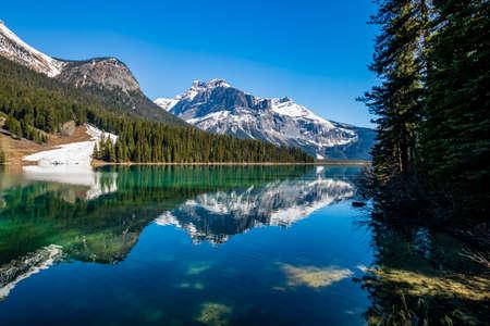 Last vestages of winter hang onto Emerald Lake. Yoho National Park. British Columbia, Canada.