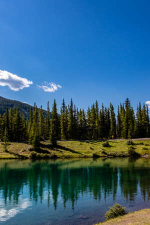 Waters and mountains surround this family favourite. Forget Me Not Provincial Recreation Area, Alberta, Canada