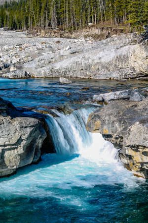 Fast flowing water rushes over the falls in summer. Elbow Falls Provincial Recreation Area, Alberta, Canada Stock Photo
