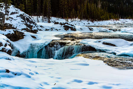 Sun glints off of the Elbow River. Elbow Falls Provinvial Recreation Park. Alberta, Canada