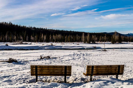 Water starting to peak through the river in late winter. Allan Bull Provincial Recreation Area. Alberta, Canada