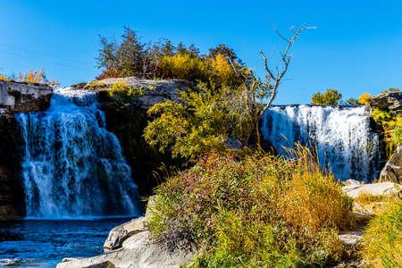 Twin falls in autumn. Lundbreck Falls Provincial Recreation Area, Alberta, Canada