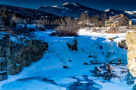 The twin falls iced over during winter. Lundbreck Falls Provincial Recreation Area, Alberta, Canada