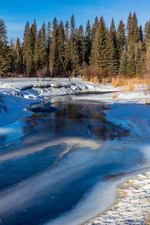 Warm weather opens the water in winter. Tay River Provincial Recreation Area, Alberta, Canada