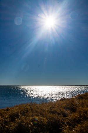 Sun glisining off the water. Lake McGregor Provincial Recreation Area, Alberta, Canada