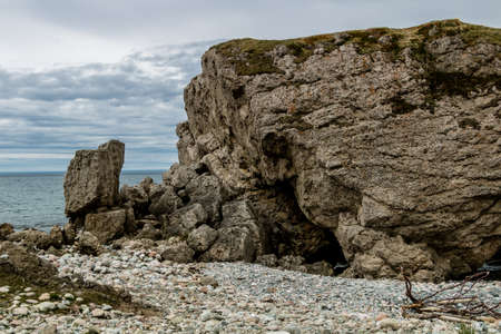 Sea stacks and caves at low tide. Arches Provincial Park, Newfoundland, Canada