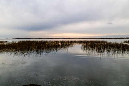 Sun setting on the fall colours around the lake. Battleford Provincial Park, Saskatchewan, Canada Stock Photo
