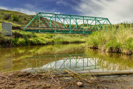 Bridge and winding creek leading into town Heskith Alberta Canada Banque d'images