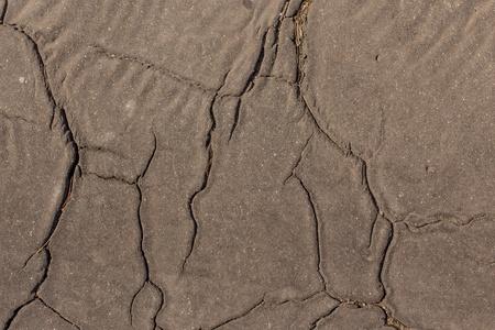 Stress cracks in asphalt road photo