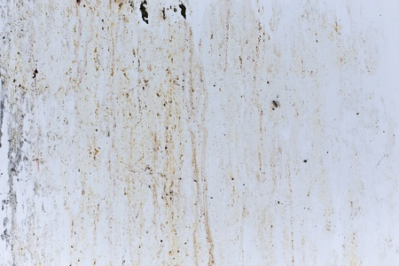 Grungy stain marks on white metal panel photo