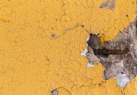 chipped: Details of a concrete yellow divider wall falling apart