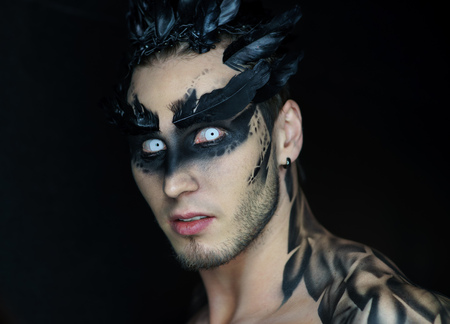Make-up of a raven or another bird on a man
