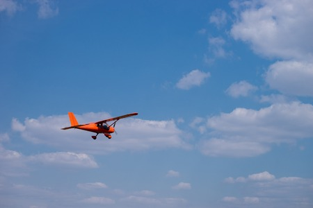 Small charter aircraft flying in a blue sky