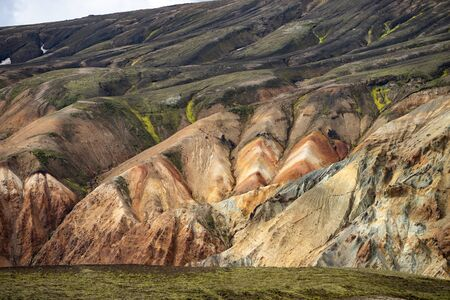 Landmannalaugar Colorful mountains on the Laugavegur hiking trail. Iceland. The combination of layers of multi-colored rocks, minerals, grass and moss