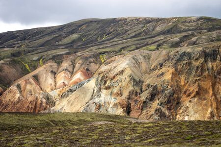 Landmannalaugar Valley. Iceland. Colorful mountains on the Laugavegur hiking trail. The combination of layers of multi-colored rocks, minerals, grass and moss