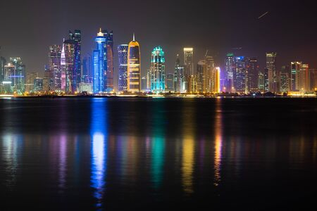 Vibrant Skyline of Doha at Night as seen from the opposite side of the capital city bay at night